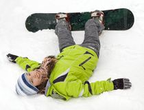 A lifestyle image of snowboarder girl. A health lifestyle image of young adult (age 18-20) snowboarder girl after incidence Royalty Free Stock Photo