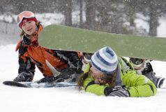 A lifestyle image two teens. A lifestyle image of two young adult  snowboarders Stock Photos