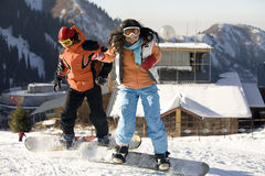 A lifestyle image of two young adult  snowboarders Royalty Free Stock Photo