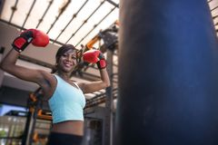 Lifestyle indoors gym portrait of young attractive and beautiful black afro American woman training happy posing playful wearing b stock images