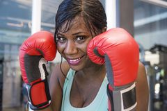 Lifestyle indoors gym portrait of young attractive and beautiful black afro American woman training happy smiling cheerful wearing Stock Photos