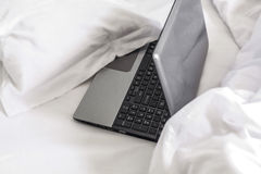 Lifestyle, laptop in bed Stock Image