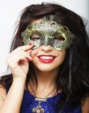 Lifestyle and people concept: beautiful brunette woman with mask. White background Stock Photo
