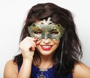 Lifestyle and people concept: beautiful brunette woman with mask. White background Stock Photos