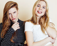 Lifestyle and people concept: Fashion portrait of two stylish sexy girls best friends, over white background. Happy time. For fun. fooling around smiling Royalty Free Stock Images