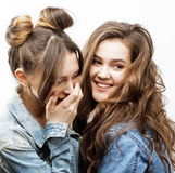 Lifestyle and people concept: Fashion portrait of two stylish sexy girls best friends, over white background. Happy time. For fun. close up Royalty Free Stock Image