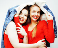 Lifestyle and people concept: Fashion portrait of two stylish sexy girls best friends, over white background. Happy time. For fun. close up Stock Image