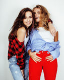 Lifestyle and people concept: Fashion portrait of two stylish sexy girls best friends, over white background. Happy time. For fun.  close up Stock Photo
