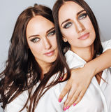 Lifestyle and people concept: Fashion portrait of two stylish sexy girls best friends, over white background. Happy time. For fun.  close up Stock Photos