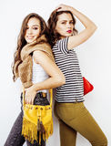 Lifestyle and people concept: Fashion portrait of two stylish sexy girls best friends, over white background. Happy time. For fun.  close up Royalty Free Stock Photography