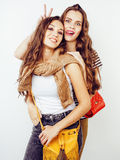 Lifestyle and people concept: Fashion portrait of two stylish sexy girls best friends, over white background. Happy time. For fun.  close up Stock Images