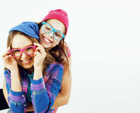 Lifestyle and people concept: Fashion portrait of two stylish sexy girls best friends, over white background. Happy time. For fun.  close up Stock Photography