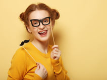 Lifestyle and people concept: Happy girl  wearing fake mustaches Stock Photography