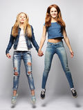 Lifestyle and people concept: Happy girls  jumping over white bq Royalty Free Stock Image