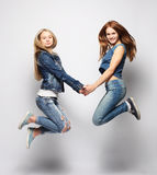 Lifestyle and people concept: Happy girls  jumping over white bq Stock Photo
