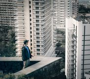 Lifestyle and people concept man looking to modern city Stock Images