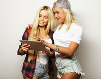 Lifestyle and people concept:two hipster girls friends  with dig Royalty Free Stock Images