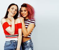 Lifestyle people concept: two pretty stylish modern hipster teen Royalty Free Stock Image