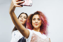 Lifestyle people concept: two pretty stylish modern hipster teen girl having fun together, diverse nation mixed races Stock Photo