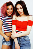 Lifestyle people concept: two pretty stylish modern hipster teen girl having fun together, diverse nation mixed races Royalty Free Stock Photography