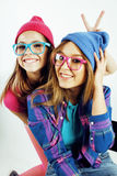 Lifestyle people concept: two pretty stylish modern hipster teen girl having fun together, happy smiling making selfie Stock Photography