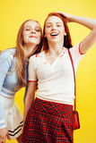 Lifestyle people concept: two pretty stylish modern hipster teen girl having fun together, happy smiling making selfie Stock Image