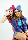 Lifestyle people concept: two pretty stylish modern hipster teen girl having fun together, happy smiling making selfie. Close up royalty free stock photography