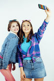 Lifestyle people concept: two pretty stylish modern hipster teen girl having fun together, happy smiling making selfie Royalty Free Stock Photos