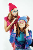Lifestyle people concept: two pretty stylish modern hipster teen girl having fun together, happy smiling making selfie Stock Photo