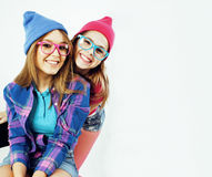 Lifestyle people concept: two pretty stylish modern hipster teen girl having fun together, happy smiling making selfie. Close up stock images