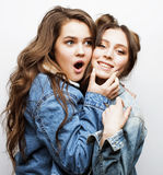 Lifestyle people concept: two pretty stylish modern hipster teen girl having fun together, happy smiling making selfie. Close upn stock images