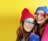 Lifestyle people concept: two pretty young school teenage girls Stock Photos