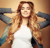 Lifestyle and people concept: Young casual woman portrait. Clean face, curly hair. Royalty Free Stock Photos