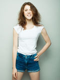 Lifestyle and people concept: Young cute smiling curly girl Stock Photos