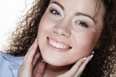Lifestyle and people concept: Young happy woman with curly hair royalty free stock photo