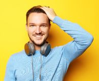 Lifestyle and people concept: young man listening to music with royalty free stock photos