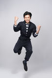 Lifestyle people concept. Young pretty asian man jumping cheerfu Stock Photos