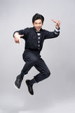 Lifestyle people concept. Young pretty asian man jumping cheerfu Stock Photography