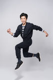 Lifestyle people concept. Young pretty asian man jumping cheerfu Royalty Free Stock Photo