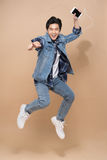 Lifestyle people concept. Young pretty asian man jumping cheerfu Royalty Free Stock Images