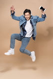 Lifestyle people concept. Young pretty asian man jumping cheerfu Stock Images