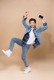Lifestyle people concept. Young pretty asian man jumping cheerfu Stock Image