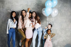 Lifestyle and people concept: young pretty diversity nations woman with different age children celebrating on birth day Stock Image