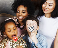 Lifestyle and people concept: young pretty diversity nations woman with different age children celebrating on birth day Royalty Free Stock Photography