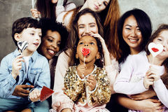 Lifestyle and people concept: young pretty diversity nations woman with different age children celebrating on birth day Royalty Free Stock Image