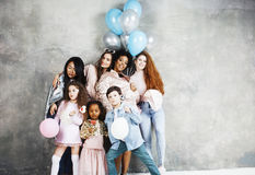 Lifestyle and people concept: young pretty diversity nations woman with different age children celebrating on birth day. Lifestyle and people concept: young Stock Photo