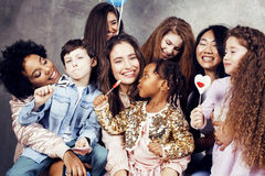Lifestyle and people concept: young pretty diversity nations woman with different age children celebrating on birth day. Lifestyle and people concept: young Stock Image