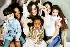 Lifestyle and people concept: young pretty diversity nations woman with different age children celebrating on birth day. Lifestyle and people concept: young Stock Photos