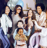 Lifestyle and people concept: young pretty diversity nations woman with different age children celebrating on birth day Stock Photography