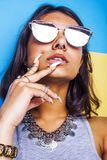 Lifestyle people concept. young pretty smiling indian girl with long nails wearing lot of jewelry rings, asian summer Stock Photography